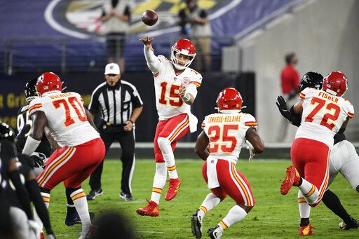 Kansas City Chiefs quarterback Patrick Mahomes (15) jumps to pass the ball during the first half of an NFL football game against the Baltimore Ravens, Monday, Sept. 28, 2020, in Baltimore.
