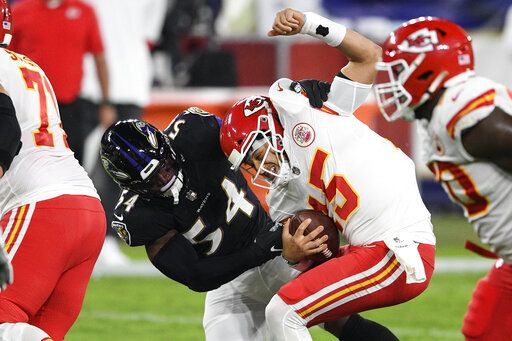 Baltimore Ravens linebacker Tyus Bowser (54) tries but cannot sack Kansas City Chiefs quarterback Patrick Mahomes (15) during the first half of an NFL football game Monday, Sept. 28, 2020, in Baltimore.