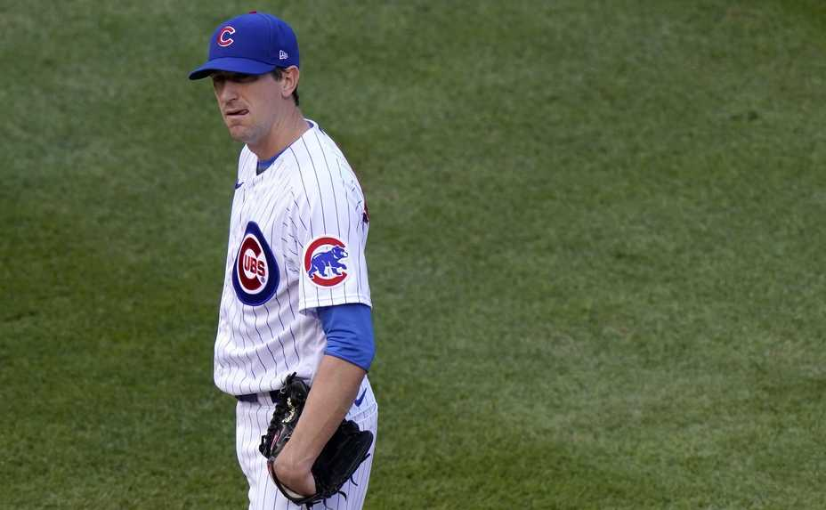 Cubs starter Kyle Hendricks stands dejected after giving up a three-run homer to Corey Dickerson in the seventh inning Wednesday at Wrigley Field.