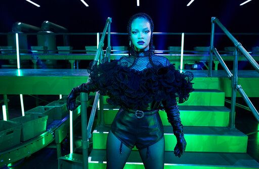 This image released by Savage X Fenty shows designer Rihanna on the set of The Savage X Fenty Show Vol. 2 Presented by Amazon Prime Video in Los Angeles. The lingerie fashion show, with musical performances, dancers and models, will drop Friday exclusively on Amazon Prime Video in more than 240 countries and territories. It's the line's second turn on the streaming platform. (Dennis Leupold/Savage X Fenty via AP)
