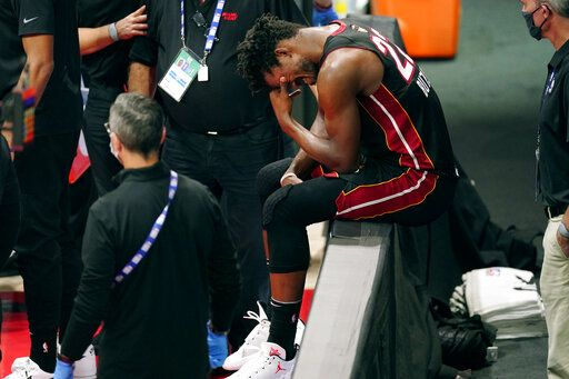 Miami Heat's Jimmy Butler (22) pauses after an apparent injury during the first half of Game 1 of basketball's NBA Finals Wednesday, Sept. 30, 2020, in Lake Buena Vista, Fla.