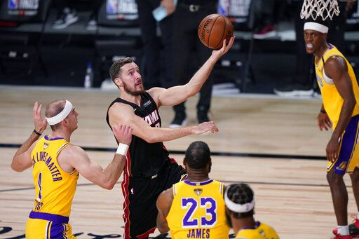 Miami Heat's Goran Dragic (7) drives to the basket against the Los Angeles Lakers during the first half of Game 1 of basketball's NBA Finals Wednesday, Sept. 30, 2020, in Lake Buena Vista, Fla.