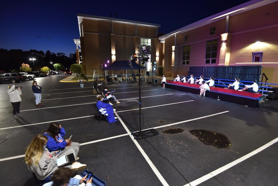 St. Viator High School students are performing their fall play in the school parking lot. The cast, crew and faculty members were putting on the finishing touches during a dress rehearsal Wednesday night.