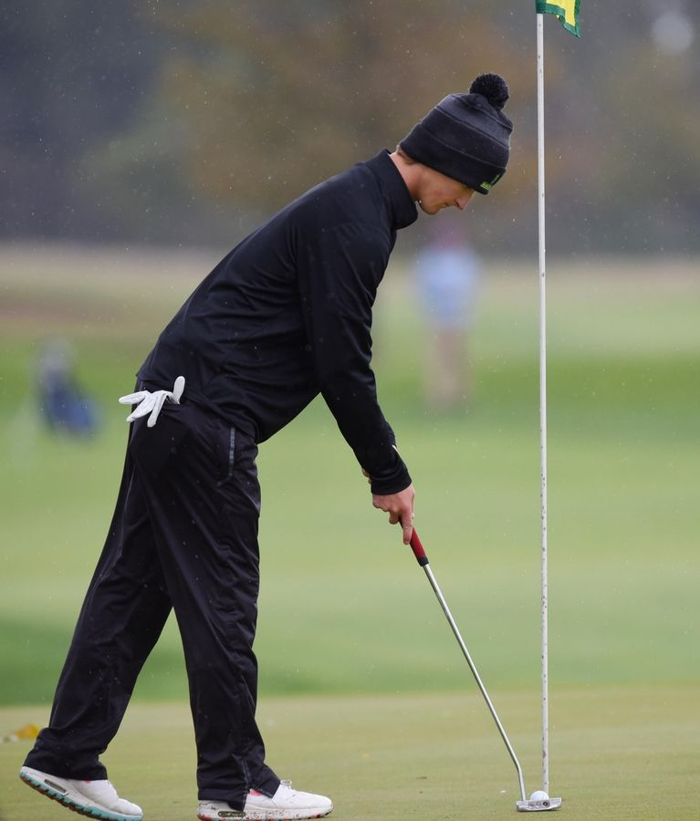 Crystal Lake South's Will Stewart taps in at the Fox Valley Conference boys golf tournament at Randall Oaks Golf Course in West Dundee Thursday.