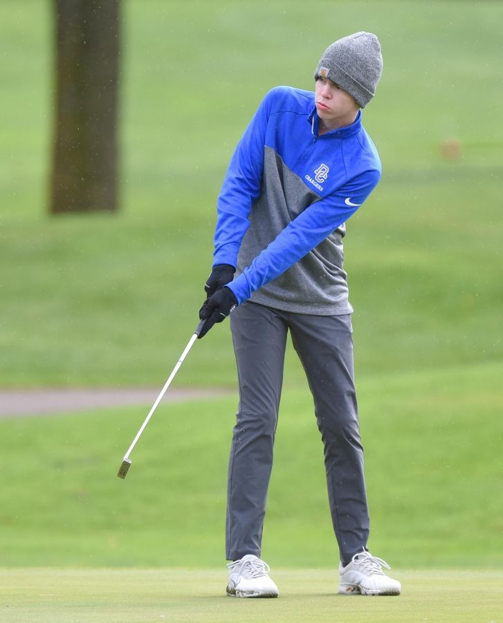 Dundee-Crown's Aidan Svec putts at the Fox Valley Conference boys golf tournament at Randall Oaks Golf Course in West Dundee Thursday.
