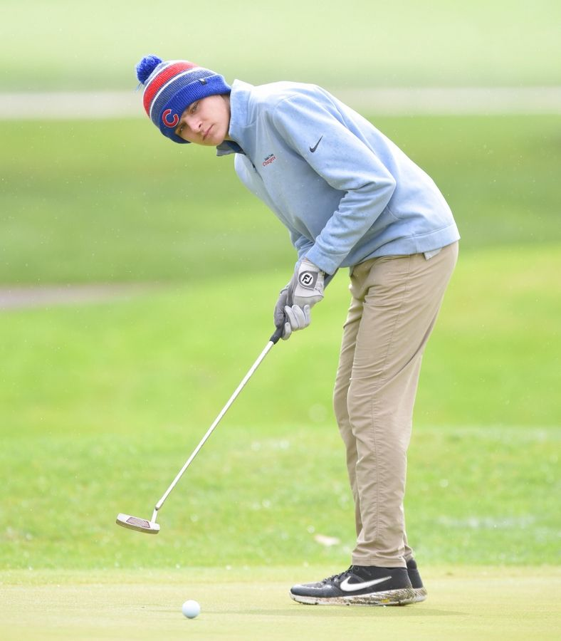 Dundee-Crown's Jake Russel putts at the Fox Valley Conference boys golf tournament at Randall Oaks Golf Course in West Dundee Thursday.