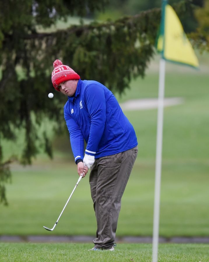 Burlington Central's Aric Beaman chips to the green at the Fox Valley Conference boys golf tournament at Randall Oaks Golf Course in West Dundee Thursday.