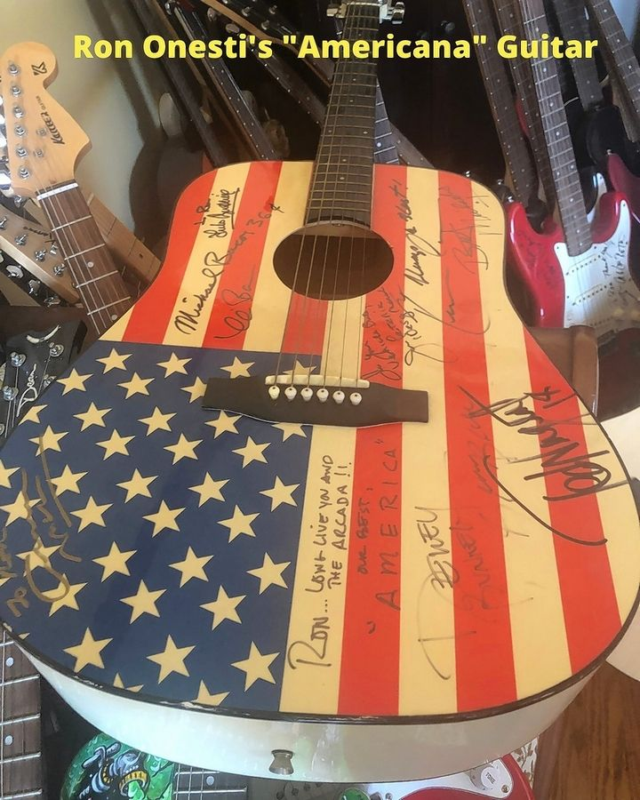Among the music memorabilia owned by Ron Onesti is this American flag guitar signed by two members of the band America, as well as other performers.