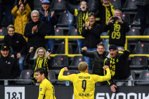 Dortmund's Erling Haaland, right, celebrates after scoring his second goal during the German Bundesliga soccer match between Borussia Dortmund and SC Freiburg in Dortmund, Germany, Saturday, Oct. 3, 2020.