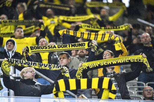 Borussia Dortmund supporters during the German Bundesliga soccer match between Borussia Dortmund and SC Freiburg in Dortmund, Germany, Saturday, Oct. 3, 2020.