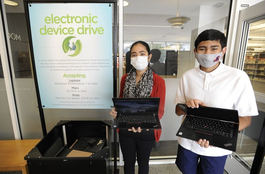 Rohan Ganeshan, 15, and grade school friend Sachleen Tuteja, 14, have been collecting donations of unneeded electronics to put them in the hands of others who need them.
