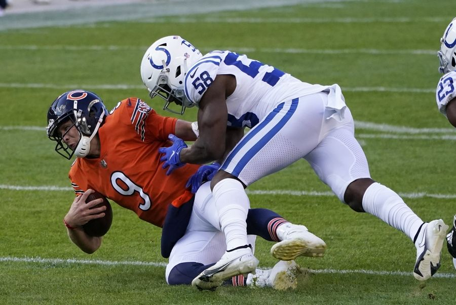 Chicago Bears quarterback Nick Foles (9) is tackled by Indianapolis Colts' Bobby Okereke (58) during the first half of an NFL football game, Sunday, Oct. 4, 2020, in Chicago.