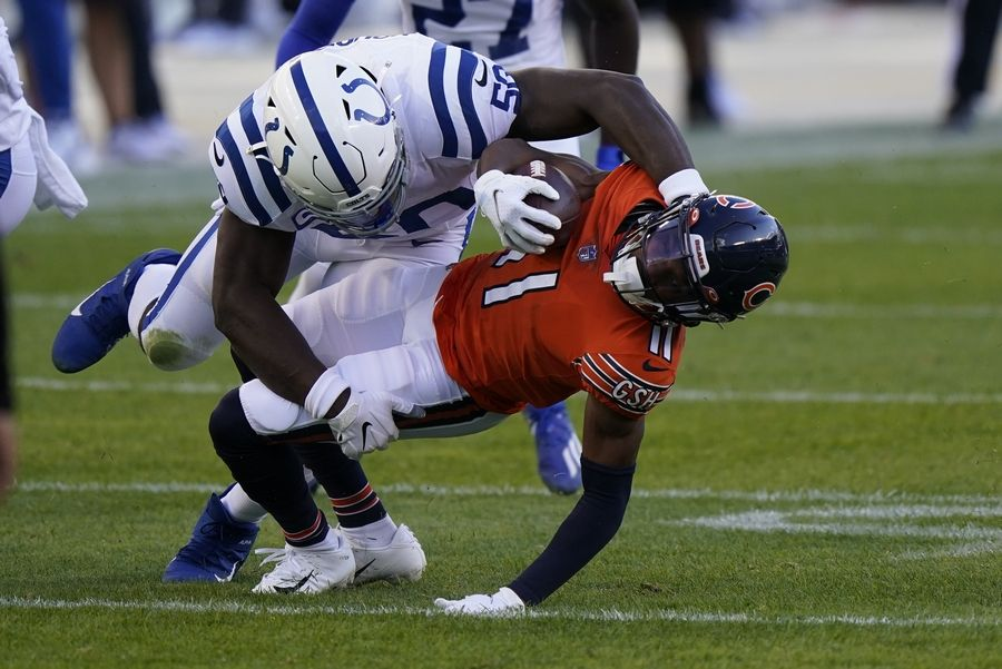 Chicago Bears' Darnell Mooney (11) is tackled by Indianapolis Colts' Justin Houston (50) during the first half of an NFL football game, Sunday, Oct. 4, 2020, in Chicago.