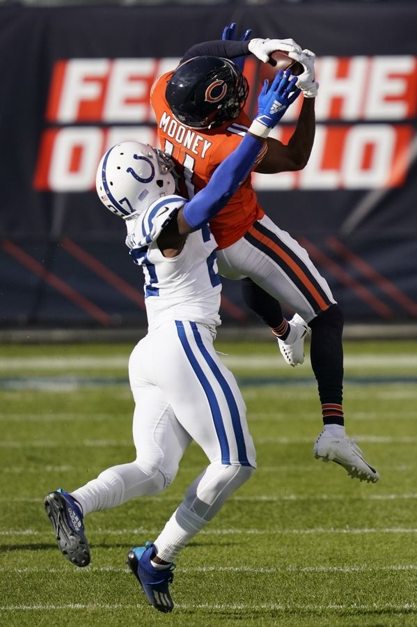 Chicago Bears' Darnell Mooney (11) makes a catch against Indianapolis Colts' Xavier Rhodes (27) during the first half of an NFL football game, Sunday, Oct. 4, 2020, in Chicago.