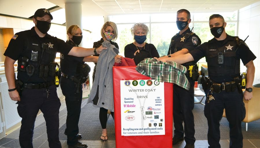 GLMV Coat Drive For Vets Kickoff with, from left, Vernon Hills Police Officers Zachary Watson and Casey Bergschneider; Kristen Svendsen and Monica Lundeen of the village of Vernon Hills; and Mundelein Police Sergeant Brian Kisselburg and Officer Steve Simonelli.