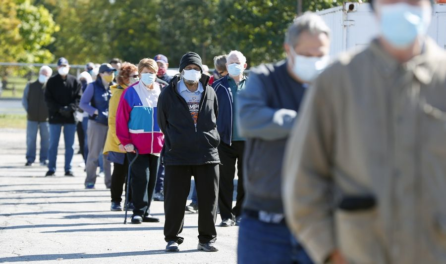A long line of early voters wraps around a building Friday at the DuPage County Fairgrounds in Wheaton.
