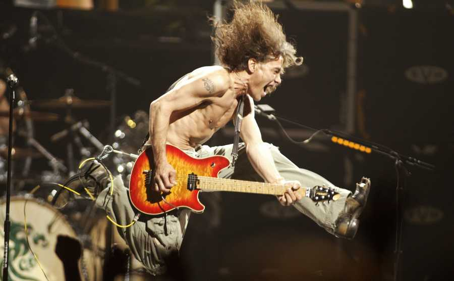 "In this June 22, 2004, file photo, Eddie Van Halen plays the final chord of ""Jump"" during the Van Halen concert at the Continental Airlines Arena in East Rutherford, N.J."