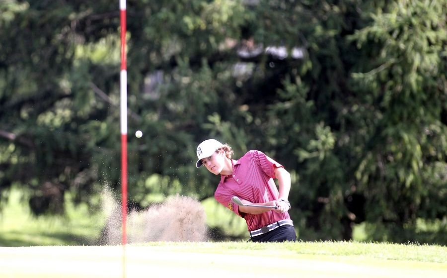 Batavia's Myles Prodoehl gets out of the sand and onto the green during the Class 3A South Elgin Regional at Bartlett Hills Golf Club on Oct. 6.