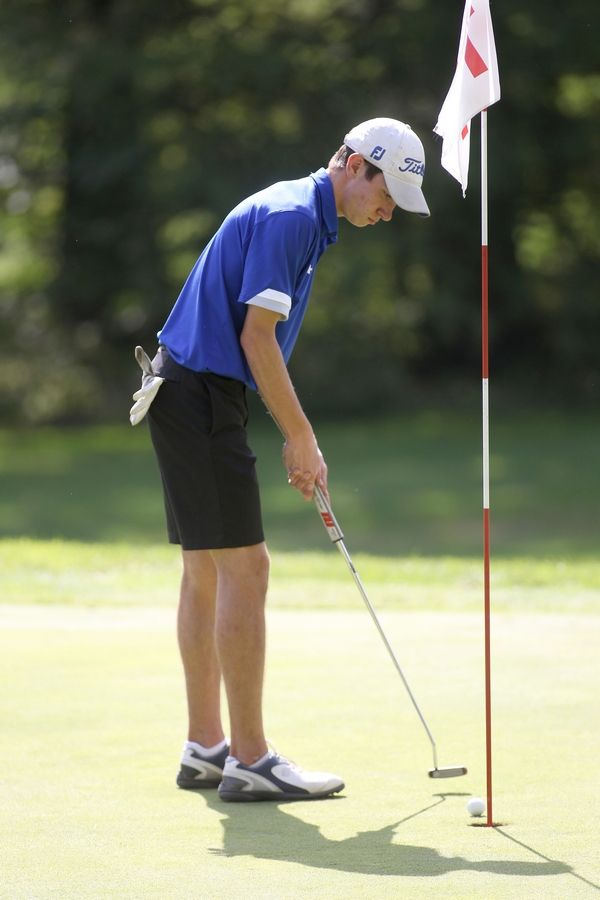 Geneva's Cal McKittrick putts during the Class 3A South Elgin Regional at Bartlett Hills Golf Club on Oct. 6.