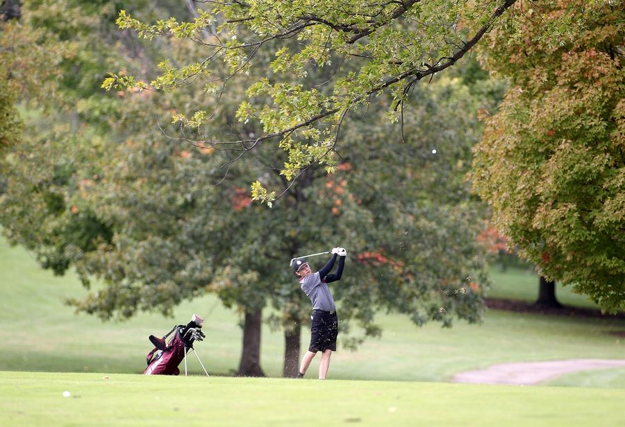 Elgin's Derrick Graves hits from the fairway during the Class 3A South Elgin Regional at Bartlett Hills Golf Club on Oct. 6.