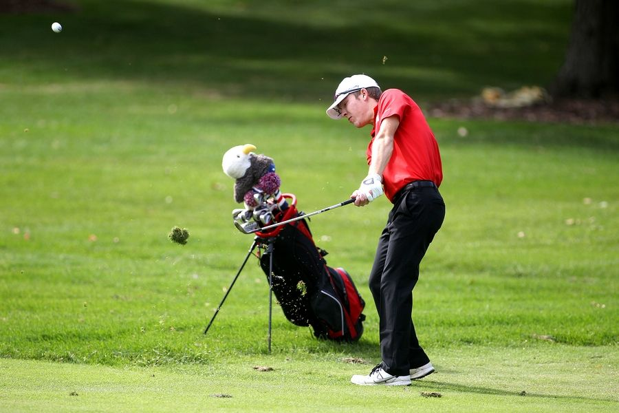 South Elgin's Nick Zaimins chips onto the green during the Class 3A South Elgin Regional at Bartlett Hills Golf Club on Oct. 6.