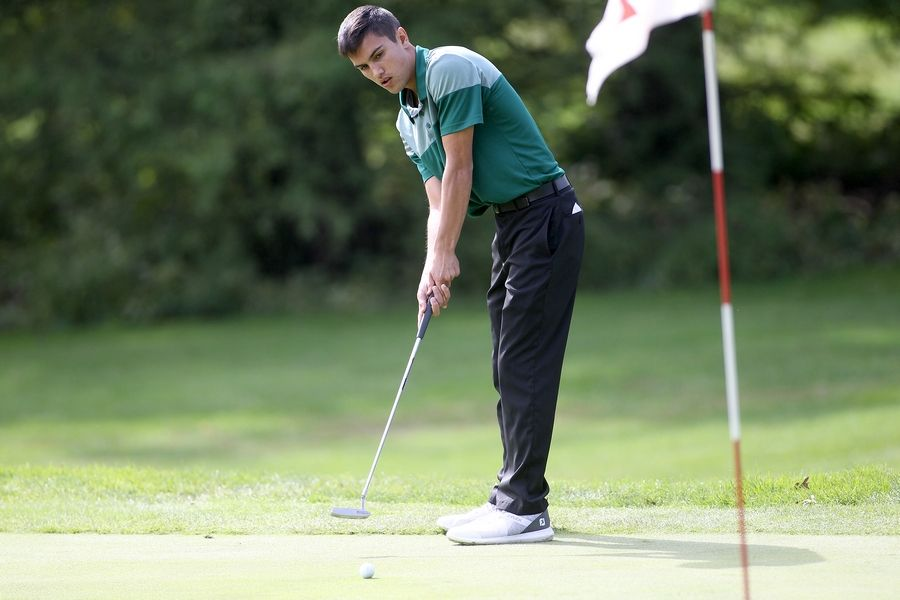 Bartlett's Clark Lewis putts during the Class 3A South Elgin Regional at Bartlett Hills Golf Club on Oct. 6.