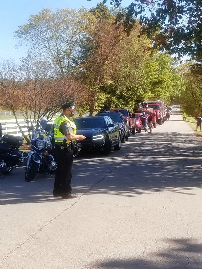 Dozens of police, fire and other municipal vehicles paraded by the Barrington Hills home of Arlington Park Chairman Emeritus Richard Duchossois on Wednesday to help him celebrate his 99th birthday.