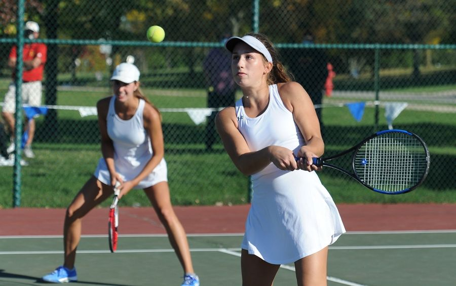 St. Charles North's Leia Papanicholas returns the ball as she and her partner Tatum Settelmyer won the DuKane Conference first doubles title at Lake Park High School's West Campus on Thursday.