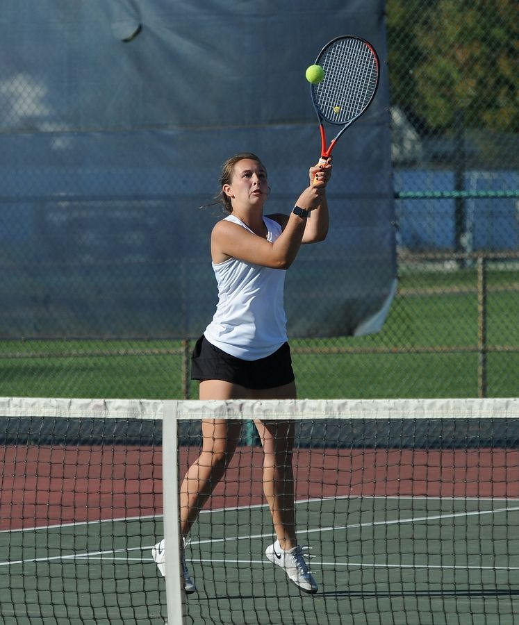 Wheaton Warrenville South's Grace Demars makes a return against St. Charles East in the third and fourth doubles match up at Lake Park High School West Campus on Thursday.