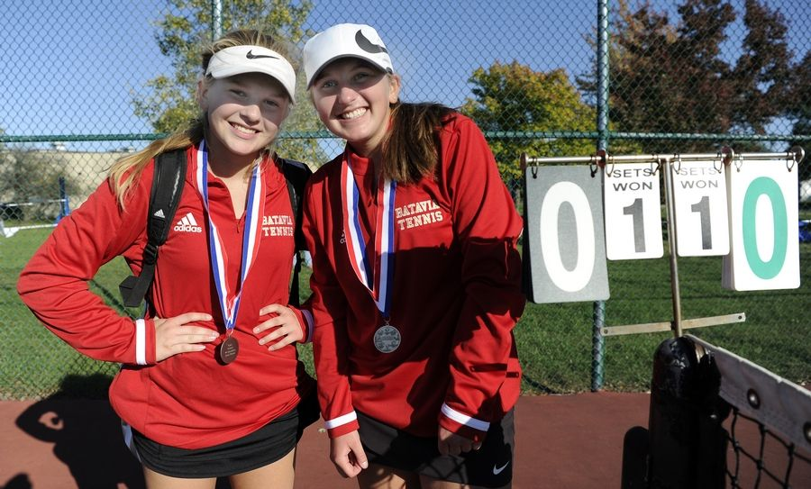 Batavia's Bella Lins (left) display their second place medals after they played St. Charles North in the number one doubles match up at Lake Park High School West Campus on Thursday.