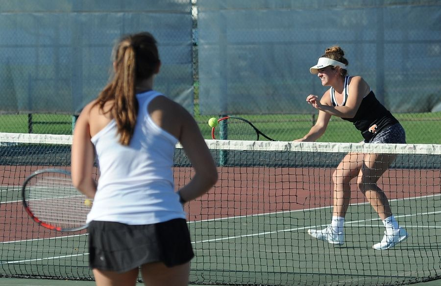 St. Charles East's Caroline Donati chases down a return from a Wheaton Warrenville South player in doubles tennis at Lake Park High School West Campus on Thursday.