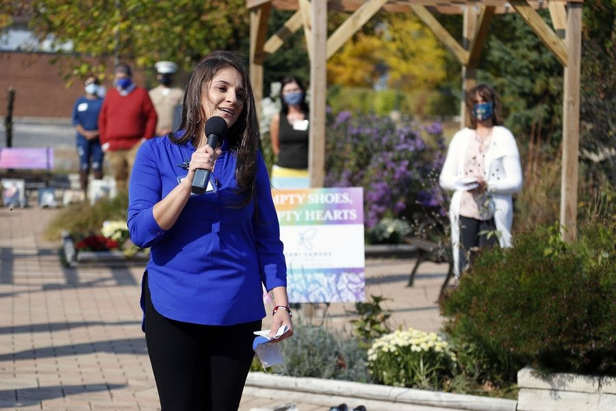 "Gabriela Vargas, chair of the new Rotary Satellite Club, SHERC, speaks Friday at the ""Empty Shoes, Empty Hearts"" youth suicide prevention event at the Children's Advocacy Center in Hoffman Estates."