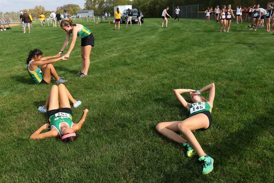 Crystal Lake South runners recover their strength after finishing in the Fox Valley Conference girls cross country meet at Plato Township Park on Saturday.