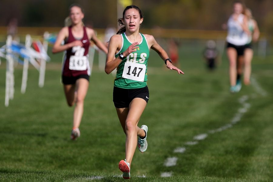 Crystal Lake South's Bella Gonzalez heads for the finish line to place first in the Fox Valley Conference girls cross country meet at Plato Township Park on Saturday.