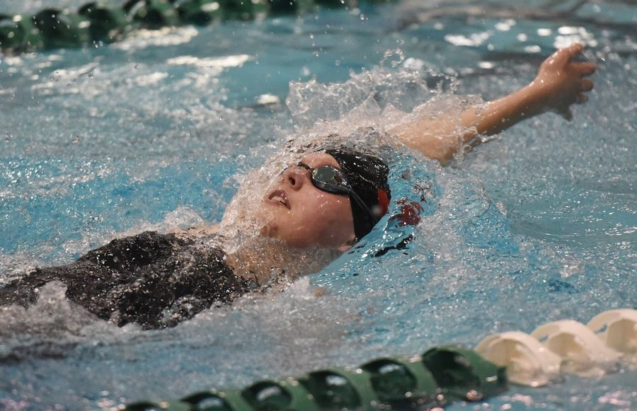 Barrington's Lilian Reader swims the 200-yard individual medley during the girls state swimming preliminaries at New Trier High School last season.
