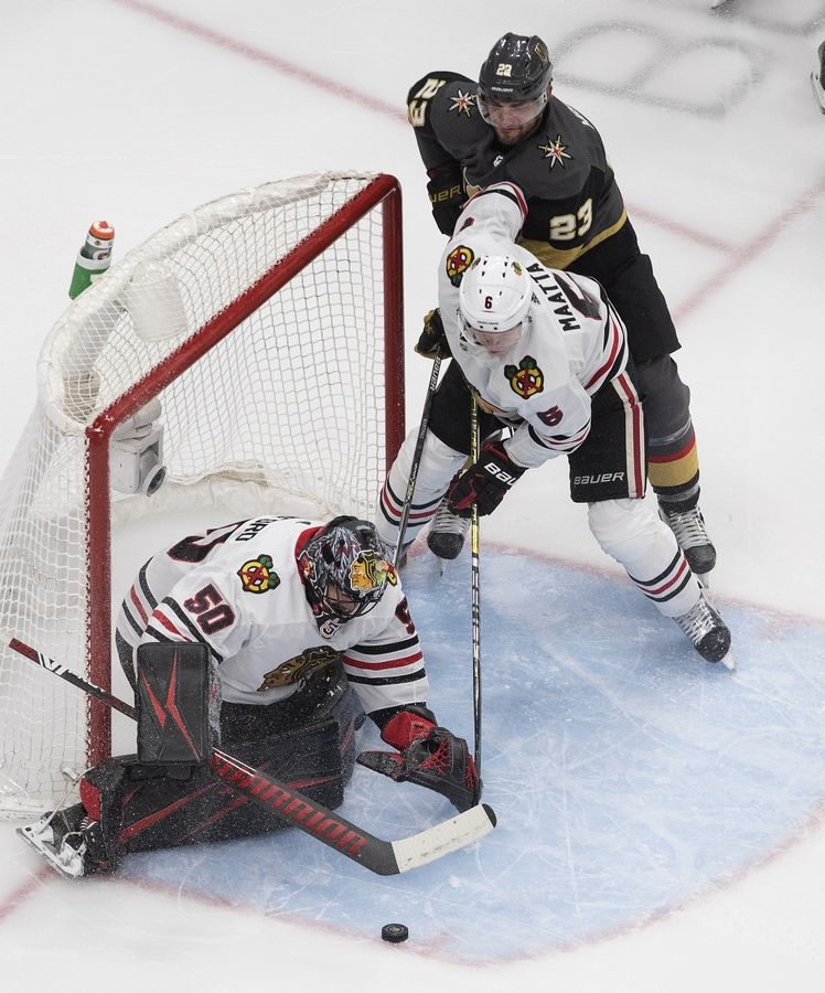 Corey Crawford (50) says he was devastated when he heard the news that the Chicago Blackhawks were not going to resign him for next season.
