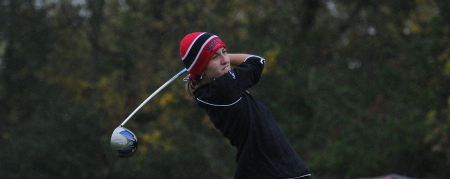 Huntley's Molly Baker eyes her ball's trajectory on the eleventh hole at girls sectional golf held at Randall Oaks Golf Club in West Dundee on Monday.