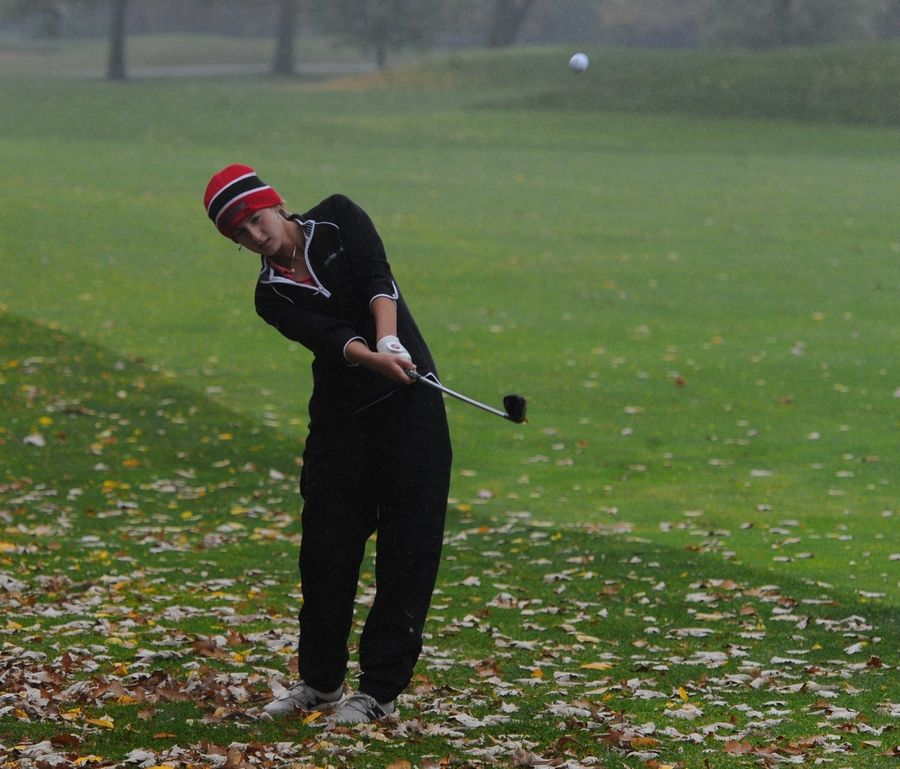Huntley's Molly Baker chips up on the tenth hole at girls sectional golf held at Randall Oaks Golf Club in West Dundee on Monday.