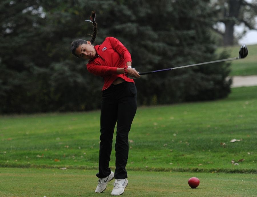 Huntley's Nina Shaffer puts her all into her drive on the first hole at girls sectional golf held at Randall Oaks Golf Club in West Dundee on Monday.