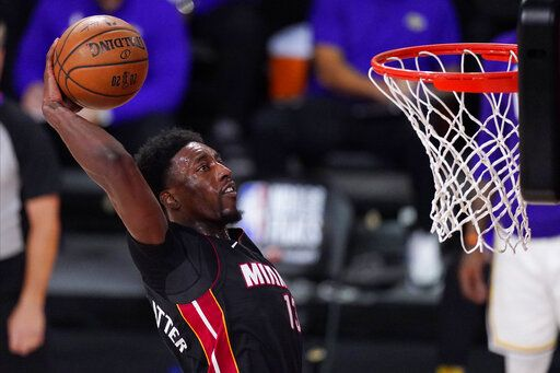 Miami Heat's Bam Adebayo (13) dunks during the second half in Game 6 of basketball's NBA Finals against the Los Angeles Lakers Sunday, Oct. 11, 2020, in Lake Buena Vista, Fla.