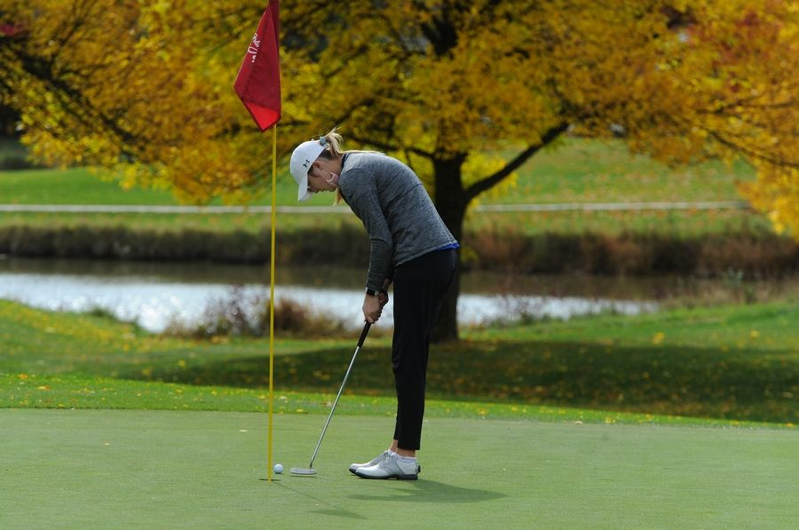 Reese Clark of Geneva sinks her putt on the third green at the girls golf sectional at Arlington Lakes Golf Club in Arlington Heights on Tuesday.