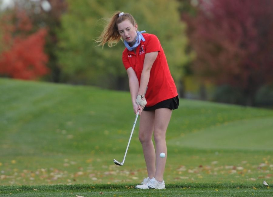 Maggie Woods of Maine South chips up from the rough on the tenth green at the girls golf sectional at Arlington Lakes Golf Club in Arlington Heights on Tuesday.
