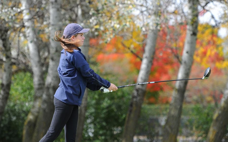 Kendall Farm of West Chicago follows the flight of her drive on the fourth hole at the girls golf sectional at Arlington Lakes Golf Club in Arlington Heights on Tuesday.