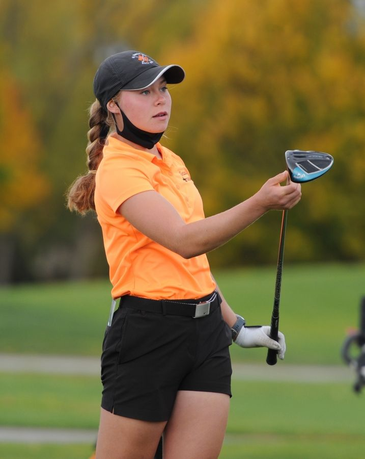 Allison Edgar of St. Charles East follows the flight of her ball on the tenth hole at the girls golf sectional at Arlington Lakes Golf Club in Arlington Heights on Tuesday.