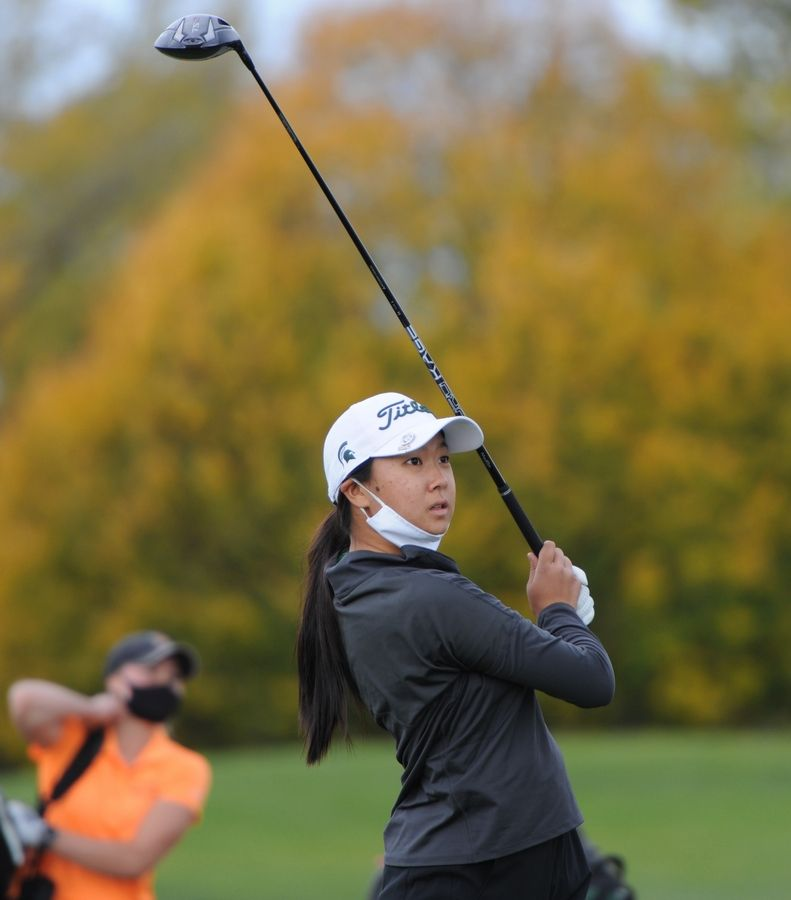 Claire Choi of Glenbrook North eyes her drive on the tenth hole at the girls golf sectional at Arlington Lakes Golf Club in Arlington Heights on Tuesday.