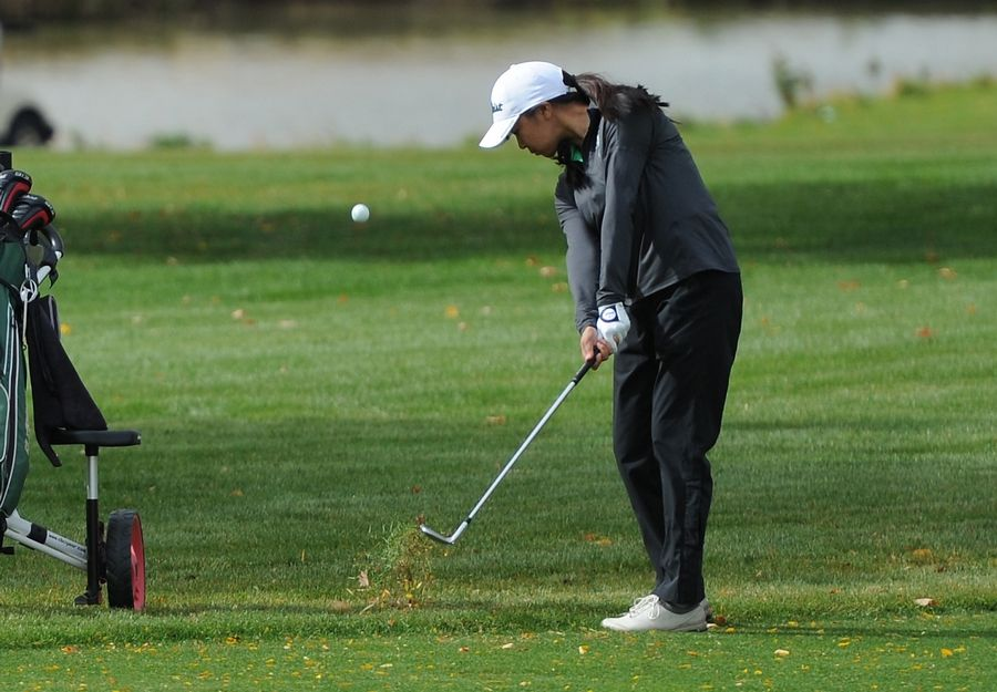 Claire Choi of Glenbrook North chips from the rough on the tenth hole at the girls golf sectional at Arlington Lakes Golf Club in Arlington Heights on Tuesday.