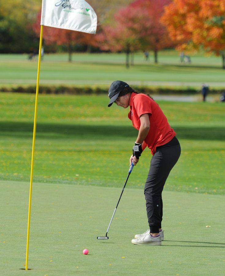 Maine South's Kendall Bertsch putts on the tenth green and falls short of the hole at the girls golf sectional at Arlington Lakes Golf Club in Arlington Heights on Tuesday.