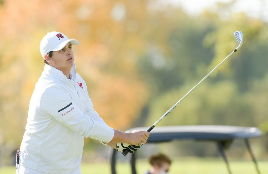 Hinsdale Central's Michael Spitzer watches his drive from the 14th tee during the Boys Golf Class 3A Oswego Sectional at Blackberry Oaks Golf Course in Bristol Oct. 13.