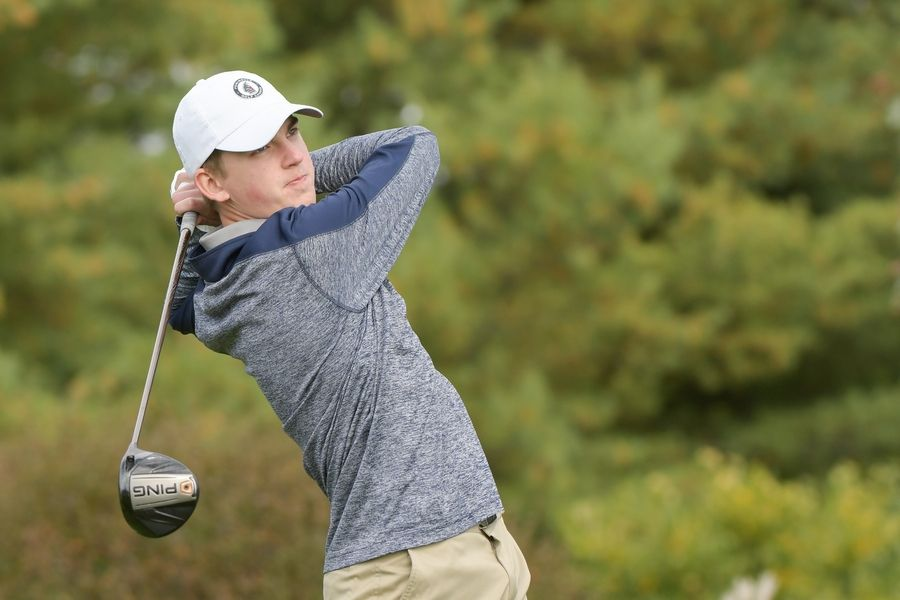 Neuqua Valley's Ryan Coan watches his drive from the 14th tee during the Boys Golf Class 3A Oswego Sectional at Blackberry Oaks Golf Course in Bristol Oct. 13.