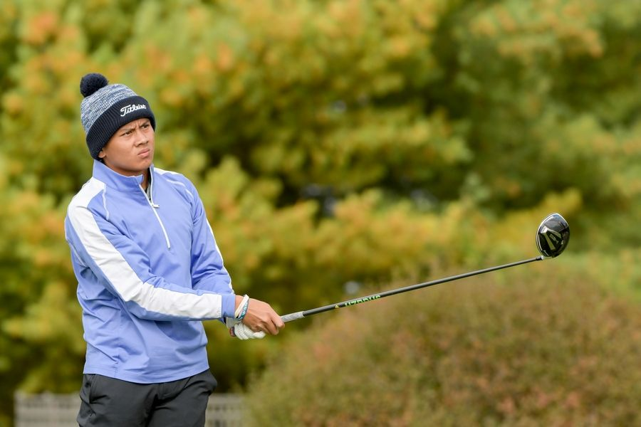 Bartlett's Francis Resurreccion watches his drive from the 14th tee during the Boys Golf Class 3A Oswego Sectional at Blackberry Oaks Golf Course in Bristol Oct. 13.